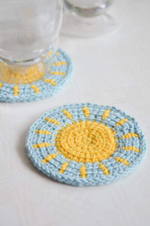 Little sun Tunisian crochet coaster pattern in use